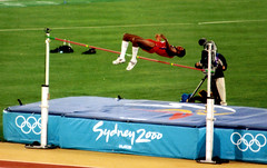 hurdle(0.0), physical exercise(0.0), athletics(1.0), track and field athletics(1.0), sport venue(1.0), sports(1.0), pole vault(1.0), high jump(1.0), player(1.0), person(1.0),