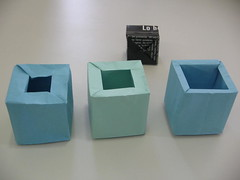 carton(0.0), packaging and labeling(0.0), lighting(0.0), art(1.0), rectangle(1.0), paper(1.0), box(1.0), blue(1.0),