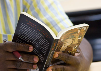 Newman University student reading a book