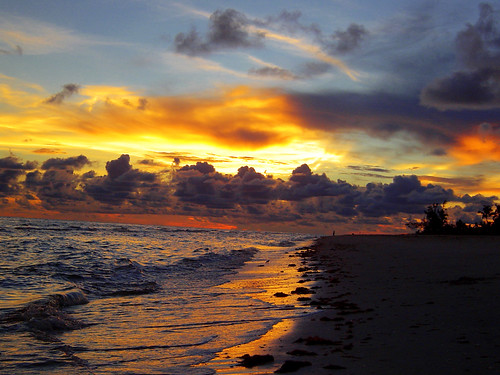 sunset orange beach yellow clouds evening sand colorful warm surf shadows florida dusk vibrant utata sanibel isolated secluded gulfcoast intoxicating lonelybeach thewaterfeltlikeheaven firstnightofvacation muchneededgetaway