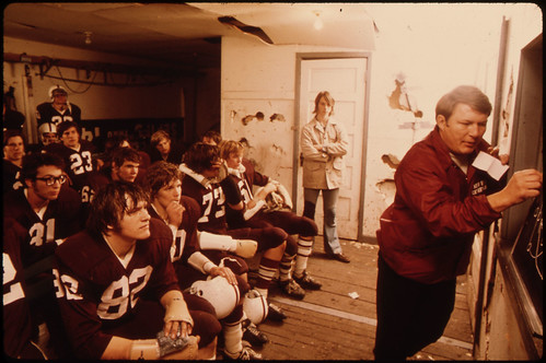 Pregame Discussion by the Coach for Cathedral Senior High School Football Players Prior to a Game at Johnson Park in New Ulm Minnesota...