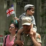 Father Carrying Son - Tbilisi, Georgia