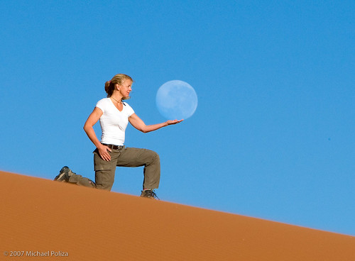 Holding the moon on the red dunes of Namibia...