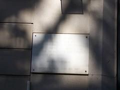 Photo of Andrés Nin white plaque