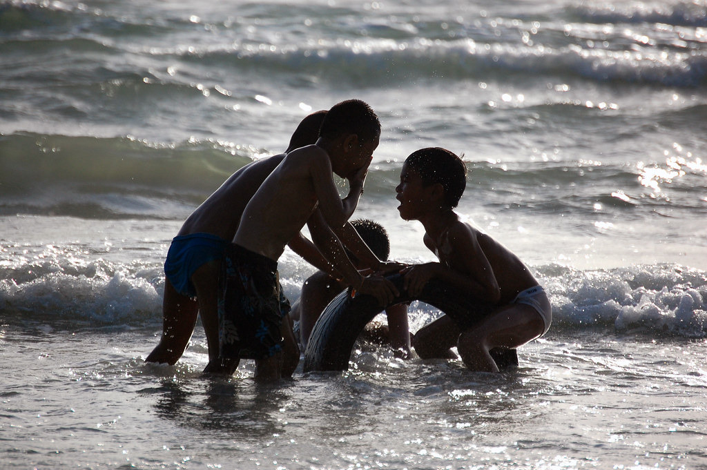 Kids Playing In A Beach Phuket Thailand By Marcusuke