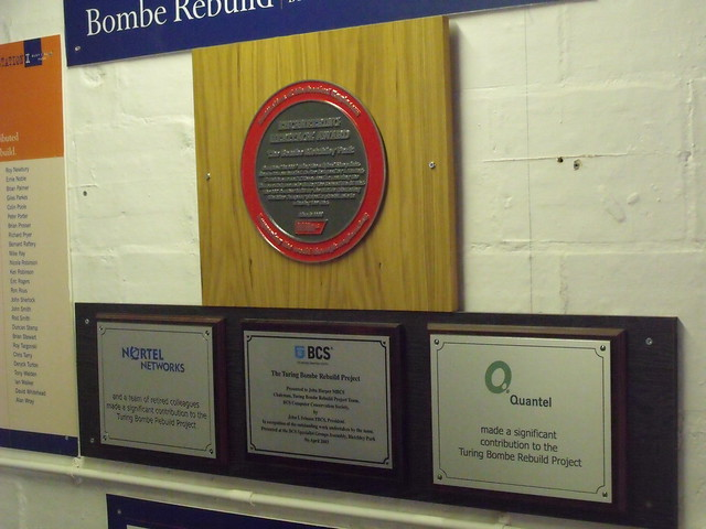 Photo of The Bombe, Alan Turing, Gordon Welchman, and Harold Keen red and black plaque