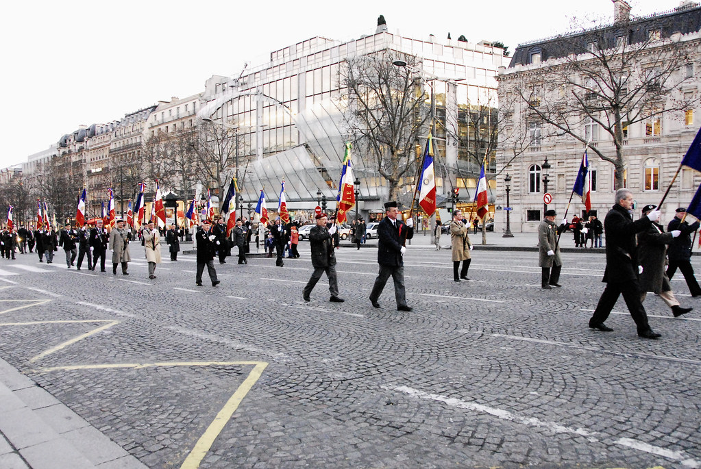 parade down Champs Elysses to L'Arc de Triomphe