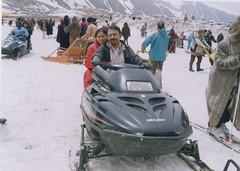 boating(0.0), auto racing(1.0), racing(1.0), winter sport(1.0), vehicle(1.0), sports(1.0), snow(1.0), motorsport(1.0), snowmobile(1.0), sled(1.0),