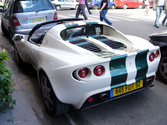 race car(1.0), automobile(1.0), lotus(1.0), vehicle(1.0), automotive design(1.0), lotus exige(1.0), land vehicle(1.0), luxury vehicle(1.0), lotus elise(1.0), supercar(1.0), sports car(1.0),