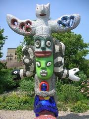 outdoor structure(0.0), monument(0.0), statue(0.0), totem pole(1.0), art(1.0), tree(1.0), sculpture(1.0),