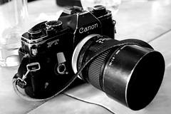 cinematographer(0.0), digital slr(0.0), camera operator(0.0), cameras & optics(1.0), digital camera(1.0), camera(1.0), single lens reflex camera(1.0), photograph(1.0), mirrorless interchangeable-lens camera(1.0), monochrome photography(1.0), monochrome(1.0), black-and-white(1.0), camera lens(1.0), black(1.0), reflex camera(1.0),