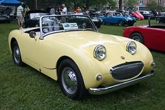 triumph tr3(0.0), automobile(1.0), vehicle(1.0), automotive design(1.0), antique car(1.0), austin-healey sprite(1.0), vintage car(1.0), land vehicle(1.0), sports car(1.0),