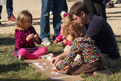 A father and daughters doing science on the Mall at the U.S. Science Festival 2010