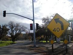 street light(0.0), lighting(0.0), signage(1.0), light fixture(1.0), signaling device(1.0), sign(1.0), road(1.0), street sign(1.0), lane(1.0), traffic sign(1.0), infrastructure(1.0), traffic light(1.0),