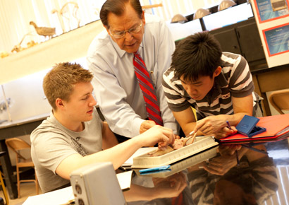 Professor Singh instructing students in class at Newman University