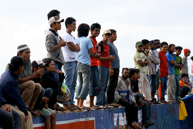 A lot of Indonesians watching a motorcycle race in Sorong.