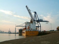 crane vessel (floating)(0.0), jackup rig(0.0), construction equipment(0.0), port(1.0), vehicle(1.0), transport(1.0), freight transport(1.0), ship(1.0), sea(1.0), dredging(1.0), container ship(1.0), waterway(1.0), infrastructure(1.0),