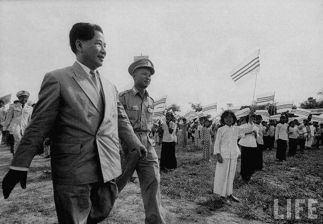 1956 President Ngo Dinh Diem (L), visiting refugee settlements.