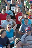 Runners wave to camera at race start