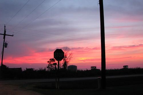sunset sky clouds farm stopsign tractors unedited