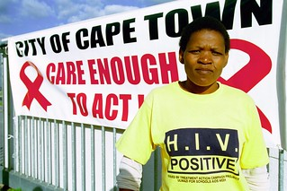 Woman holding an AIDS awareness campaign. South Africa | by World Bank Photo Collection