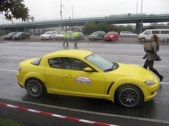muscle car(0.0), automobile(1.0), automotive exterior(1.0), wheel(1.0), vehicle(1.0), automotive design(1.0), rim(1.0), land vehicle(1.0), luxury vehicle(1.0), mazda rx-8(1.0), sports car(1.0),