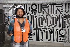 WALLWORKS: RETNA in front of his mural at The Cosmopolitan of Las Vegas