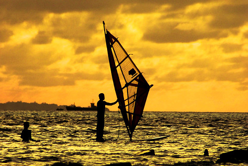 Wind surfer and his partner