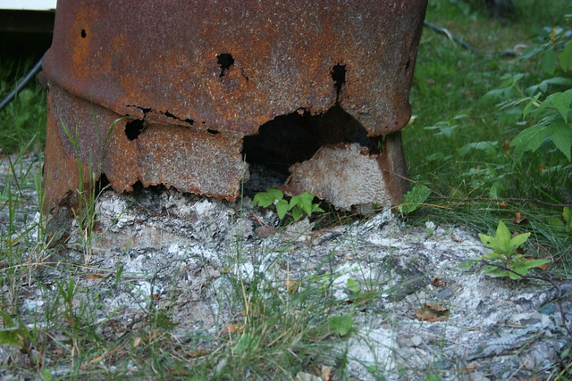 rusty trash barrel