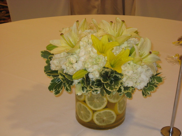 White hydrangea and lily centerpiece with lemon slices
