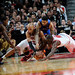 Taj, Luol, and Wilson Chandler fight for the loose ball