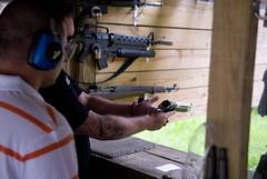 weapon(1.0), shooting sport(1.0), shooting(1.0), sports(1.0), shooting range(1.0), firearm(1.0), gun(1.0),