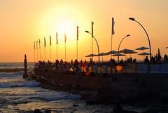 Flags. Sunset. Sea.