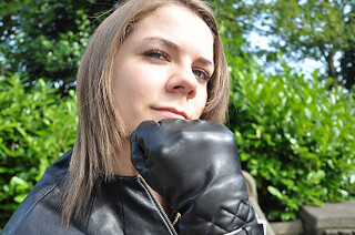 Girl in leather gloves and jacket
