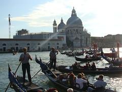 rowing(0.0), vehicle(1.0), watercraft rowing(1.0), boating(1.0), gondola(1.0), watercraft(1.0), boat(1.0), waterway(1.0),