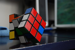 design(0.0), rubik's cube(1.0), red(1.0), blue(1.0), mechanical puzzle(1.0), toy(1.0),