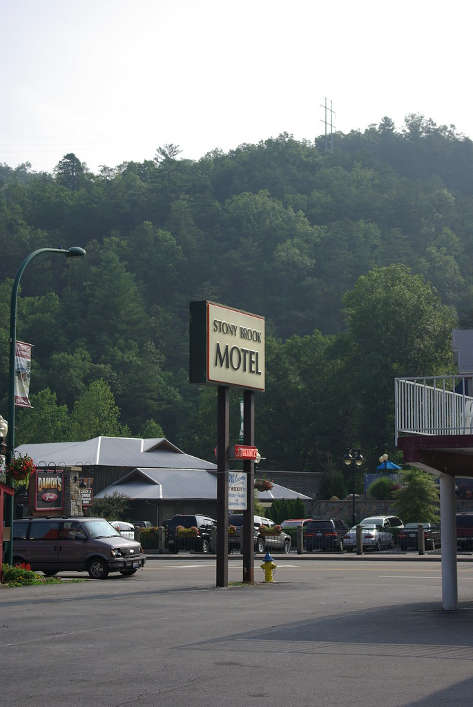 """Stony Brook Motel"" sign with mountain in the background"