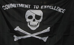 clothing(0.0), sportswear(0.0), brand(0.0), t-shirt(0.0), white(1.0), font(1.0), bone(1.0), black(1.0), skull(1.0),