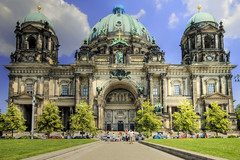 Get the large   view!  The Berliner Dom or Berlin Cathedral in Berlin, Germany was built between 1895 and 1905. It faces the Lustgarten and the Berliner Stadtschloss (Berlin City Palace).  Later the church of the Dominican Order (Schwarze Brüder), located at the south side of the castle, was used as the first cathedral. The first church at this site was a baroque cathedral by Johann Boumann, which was completed in 1747 and, in 1822, remodelled in the neoclassicist style by the Berlin architect Karl Friedrich Schinkel.  In 1894, on German Emperor Wilhelm II's order, this domed building was demolished and replaced by the current cathedral designed by Julius Raschdorff. At 114 m long, 73 m wide and 116 m tall, it was much larger than any of the previous buildings and was considered a Protestant counterweight to St. Peter's Basilica in Vatican City.  During the Second World War, the building was bombed by the Allies and severely damaged. A temporary roof was installed to protect what remained of the interior and in 1975 reconstruction started. The restoration of the interior was begun in 1984 and in 1993 the church reopened. During reconstruction, the original design was modified into a simpler, less tall form.   From Wikipedia, the free encyclopedia