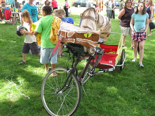 Massasauga rattler costume on bike with trailer, Procession of the Species 2010