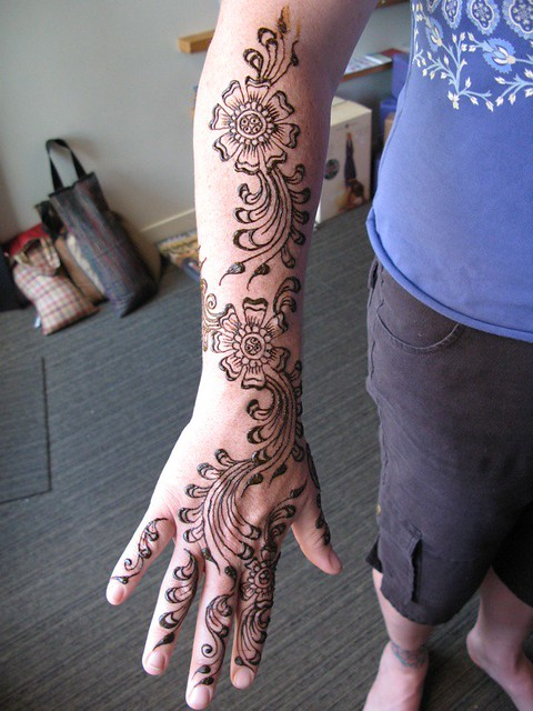 henna (mehndi) flowers on the arm and hand of jen