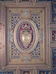 tapestry(0.0), prayer rug(0.0), flooring(0.0), archaeological site(0.0), art(1.0), mosaic(1.0), symmetry(1.0),