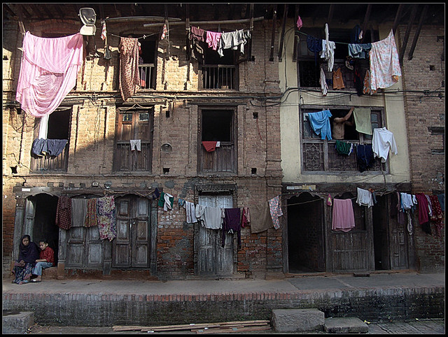 Clothes, Doors, windows, few families and.... One Rusty Building
