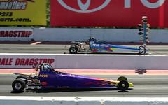 formula racing(0.0), race of champions(0.0), motorcycle racing(0.0), indycar series(0.0), formula one(0.0), formula one car(0.0), drink(0.0), auto racing(1.0), racing(1.0), sport venue(1.0), vehicle(1.0), sports(1.0), race(1.0), open-wheel car(1.0), motorsport(1.0), drag racing(1.0), race track(1.0),