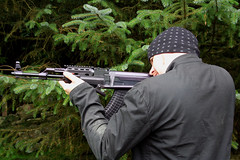 sports(0.0), weapon(1.0), shooting sport(1.0), shooting(1.0), firearm(1.0), gun(1.0),