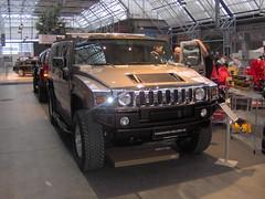hummer h1(0.0), automobile(1.0), automotive exterior(1.0), military vehicle(1.0), sport utility vehicle(1.0), vehicle(1.0), hummer h3(1.0), auto show(1.0), hummer h2(1.0), hummer h3t(1.0), bumper(1.0), land vehicle(1.0), luxury vehicle(1.0), motor vehicle(1.0),