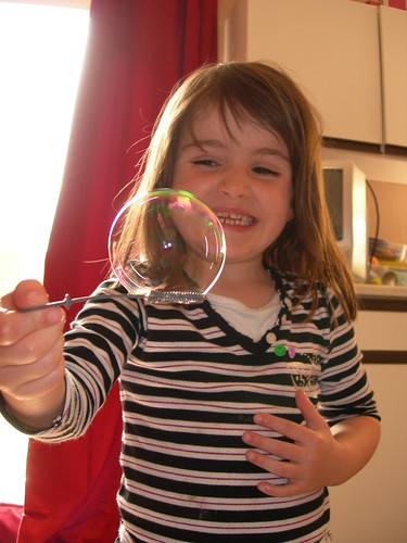 A child blowing bubbles.