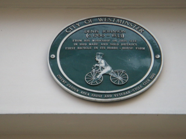 Denis Johnson green plaque - Denis Johnson  (c. 1760 - 1833)  From his workshop on this site  in 1819 made and sold Britain's  first bicycle in its hobby-horse form