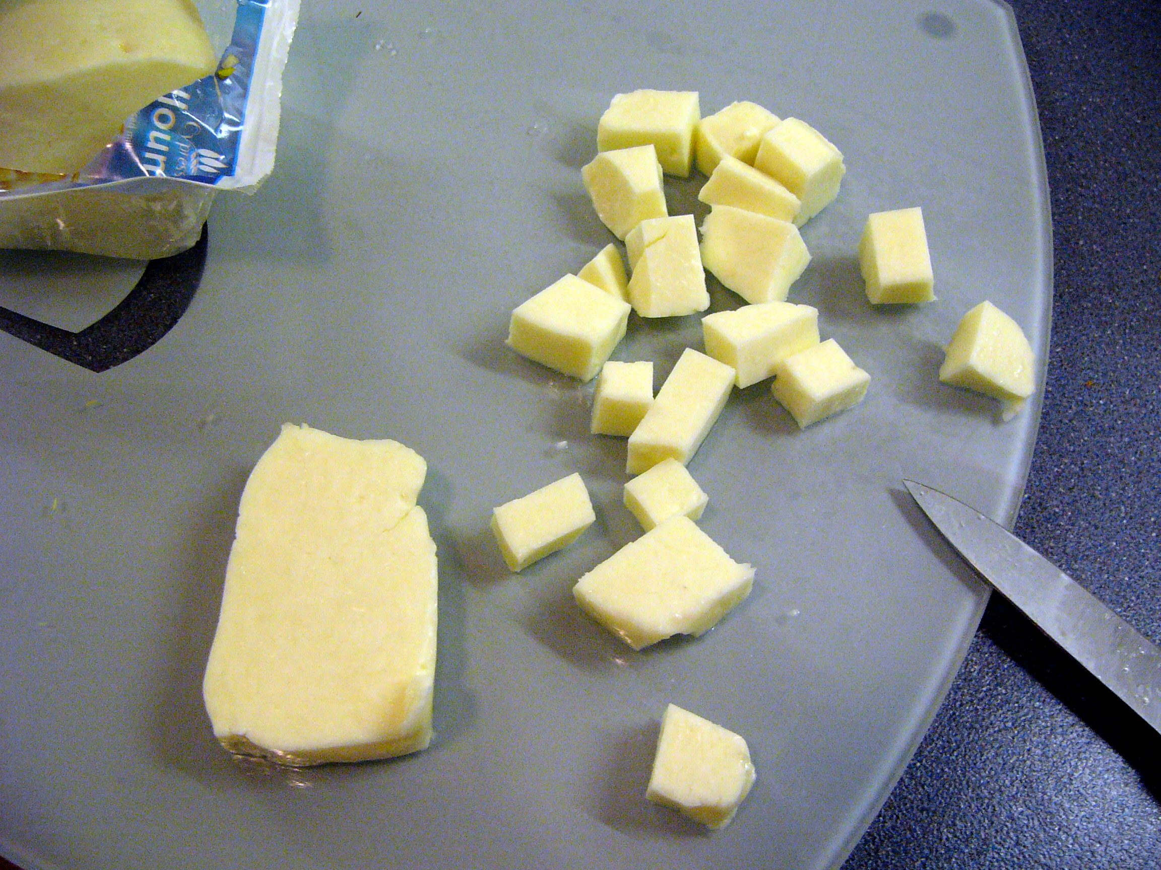 Halloumi being cubed