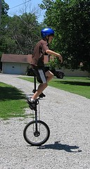 mountain bike(0.0), bicycle motocross(0.0), bmx bike(0.0), flatland bmx(0.0), sports equipment(0.0), cycle sport(0.0), extreme sport(0.0), bicycle(0.0), unicycle(1.0), vehicle(1.0), cycling(1.0), land vehicle(1.0),